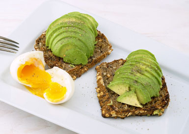 Avocado toast and a soft boiled egg - healthy snack for spring